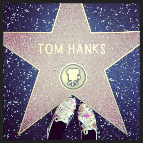 Spangly new shoes posing in Hollywood Boulevard  with Tom Hanks' star!